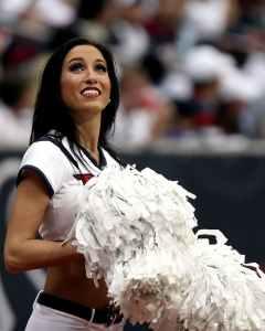 closeup photo of cheerleader holding white pompom